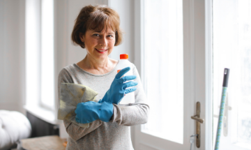 Trusted By Many Picture of Lady with cleaning product